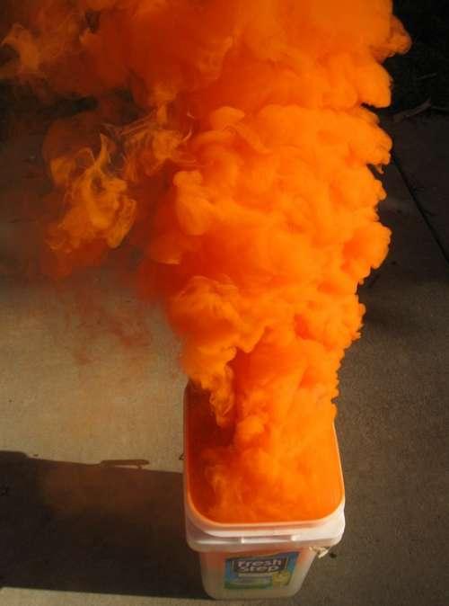 Orange Smoke Distress Signal Military Ocean Sea