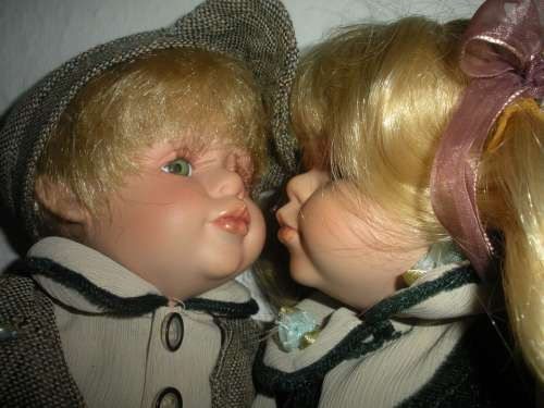 Porcelain Dolls Kissing Close-Up Sweet Dolls Kiss