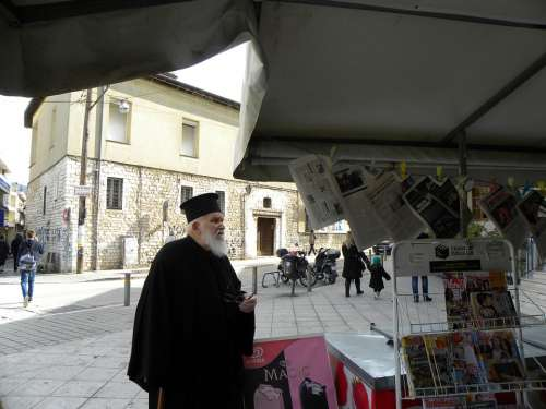 Priest Greece Ioannina Downtown Newspaper Media
