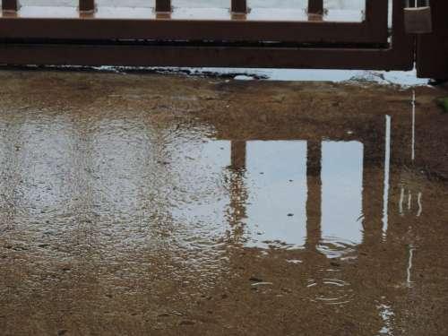 Rain Gate Sidewalk Reflection