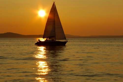 Sailing Boat Sunset Sea Surface Reflection Yellow