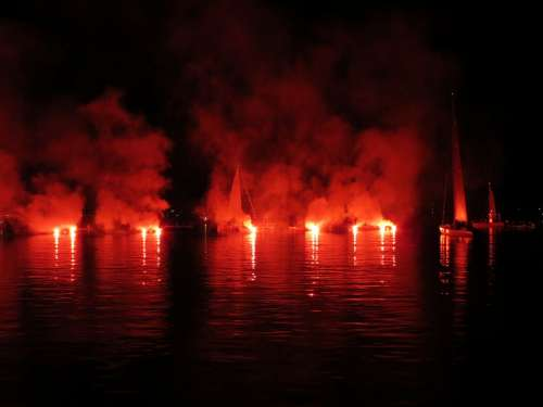 Sailor Torches Lights Lake In Flames Water Boats