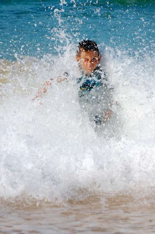 Splashing Wave Crashing Beach Boy Surf Sand