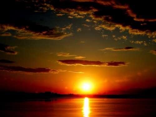 Sunset Sun In The Evening Water Landscape Cloud