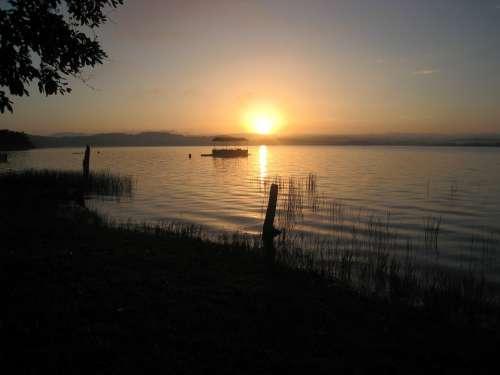 Sunset Lakeshore El Remate Guatemala
