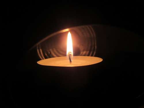 Tealight Candle Shining Light In The Dark Hope