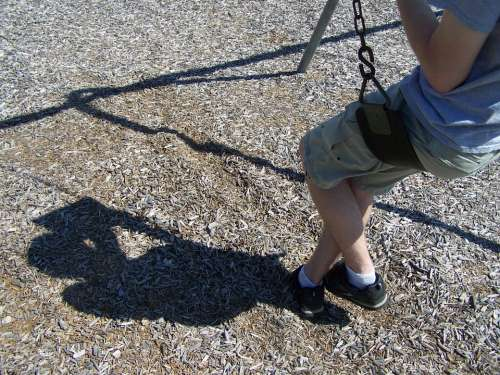 Teen Playground Swing Shadow Book Reading Park
