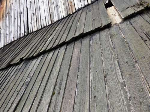 The Roof Of The Boards Cottage Village Damage