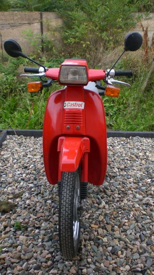 Two Wheeled Vehicle Roller Red Motor Scooter