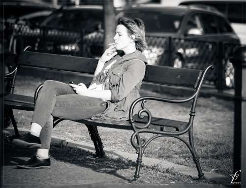 Woman Smoking Cigarette Sitting Resting Bank