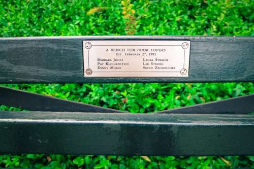 Bench for book lovers. Central Park, New York.