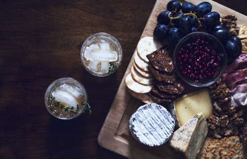 A Cheese And Fruit Board With Cocktails Photo