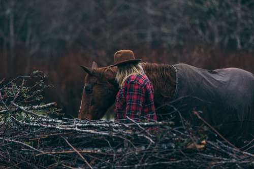 A Cowgirl And Her Horse Photo