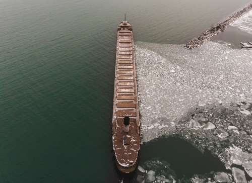 A Ship Stops The Ice From Floating Away Photo
