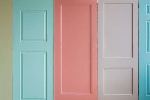 A Wall Of Pastel Colored Doors Photo