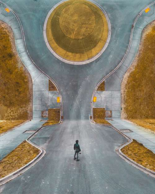 Abstract Image Of Man Standing In Road Photo