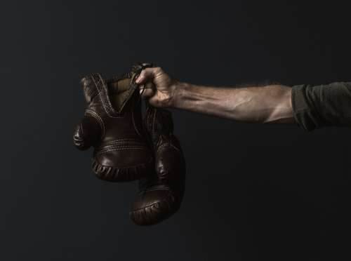Antique Boxing Gloves In Hand Photo
