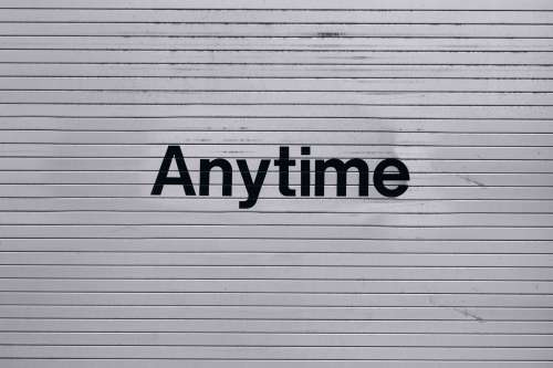 Anytime Sign On Wall Photo