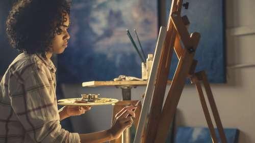 Artist Painting In Studio Photo