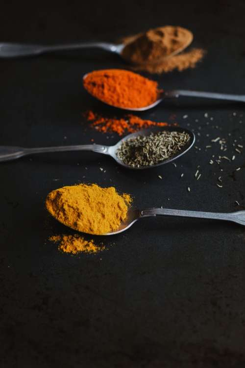 Assorted Cooking Spices In Spoons Photo