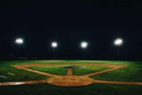Baseball Diamond Lit At Night Photo