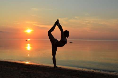 Beach Yoga Pose- In Sand At Sunset Photo