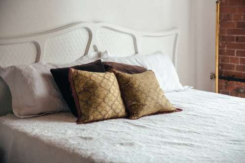 Bedroom Bed With Brown Throw Pillows Photo