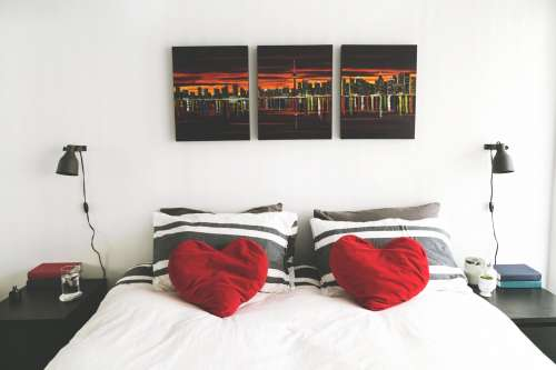 Bedroom With Heart Pillows Photo