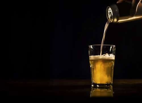 Beer Pouring From Can To Glass Photo
