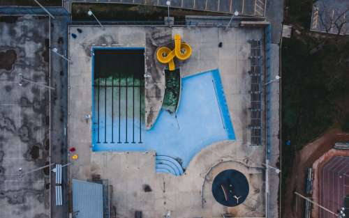 Birds Eye View Of Empty Pool With Waterslide Photo