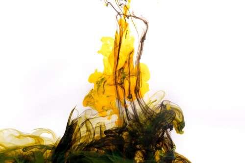 Black And Yellow Ink Streams Upwards Photo