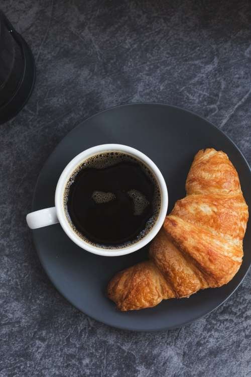 Black Coffee And A Croissant Photo
