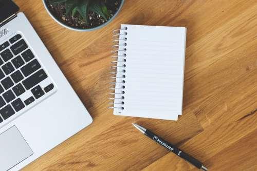 Blank Notepad On A Desk Photo