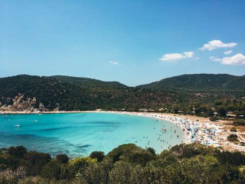 Blue Water Bay With Busy Beach Photo