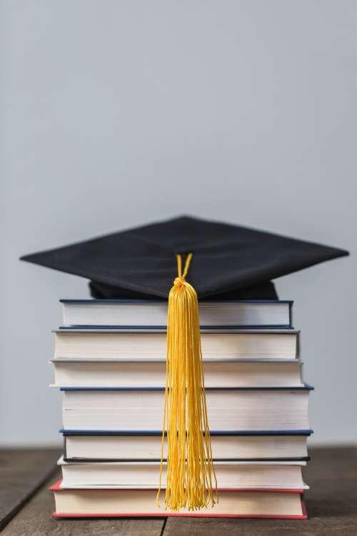 Books And Graduation Cap Photo
