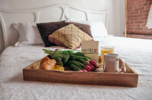 Breakfast On Bed With Flowers For Mom Photo