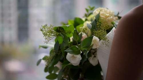 Bride Clasps Her Bouquet Photo