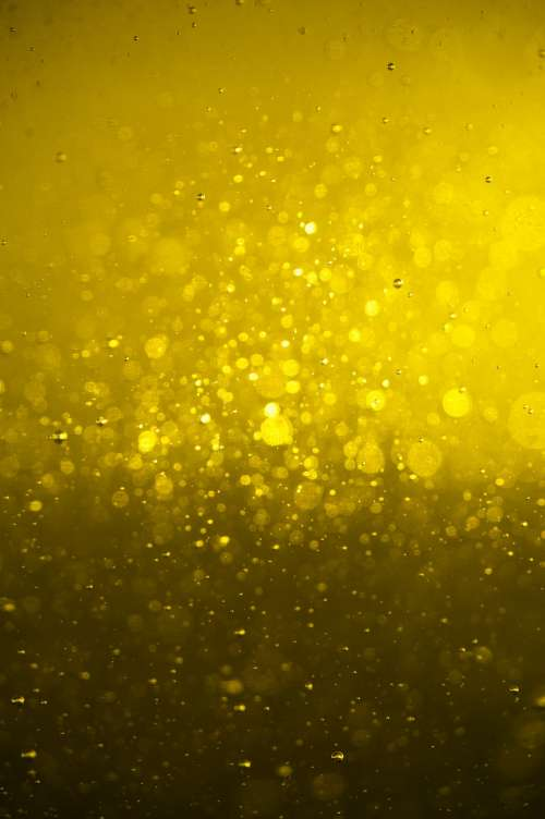 Bright Golden Oil Closeup Texture Photo