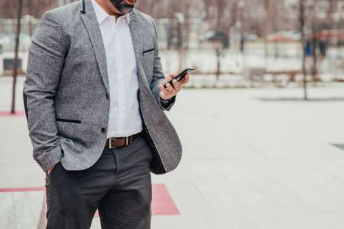 Business Man Checks Mobile Photo