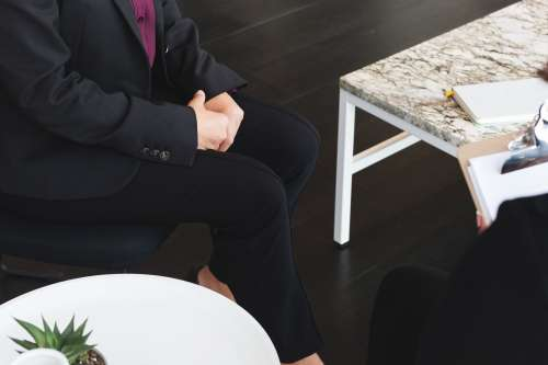 Business Woman Sits For Job Interview Photo