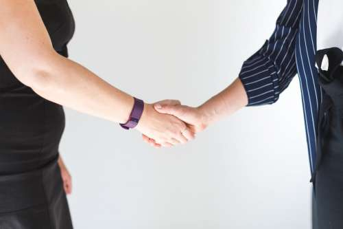 Business Women Shaking Hands Photo