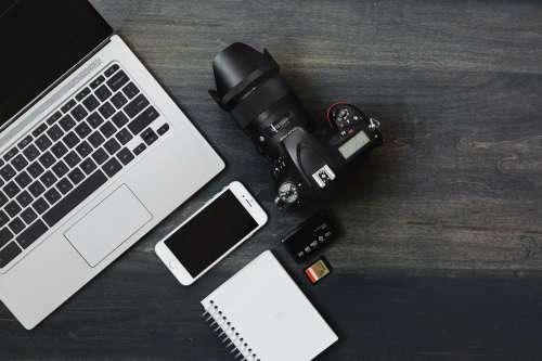 Camera, Phone, Laptop a Photographer's Desk Photo