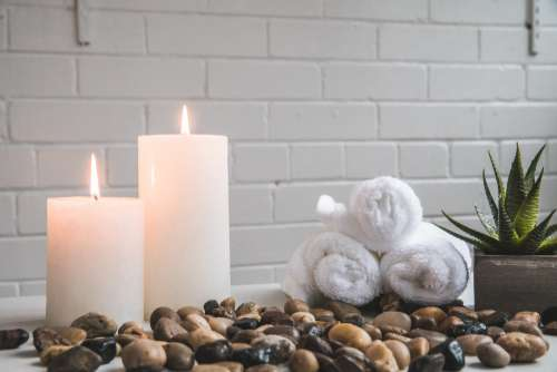 Candles Stones And Towels Photo