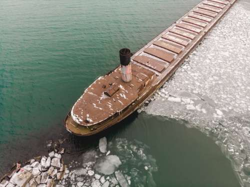 Cargo Ship Surrounded By Ice Photo