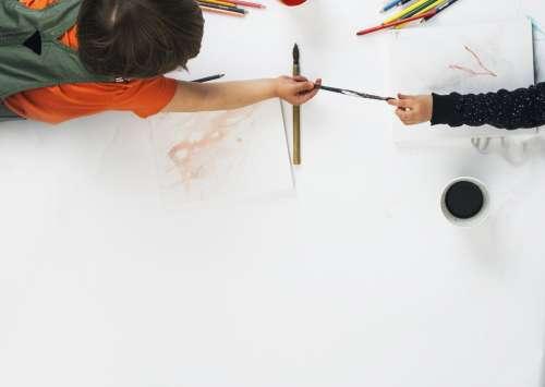 Children Sharing Paint Brush Photo