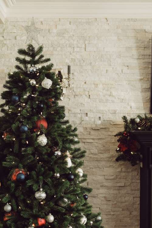 Christmas Tree In Modern Home By Mantle Photo
