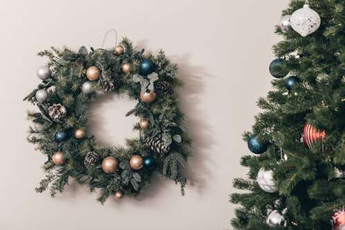 Christmas Wreath Hung By The Tree With Care Photo