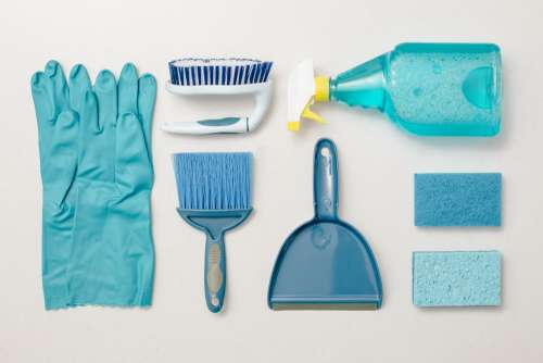 Cleaning Blue Knolling Flatlay Photo