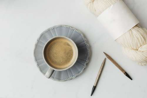 Coffee In A Tea Cup And Wool For Knitting Photo