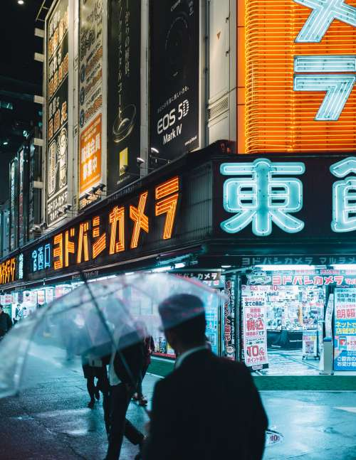 Commuters On The Streets Of Neon Tokyo Photo